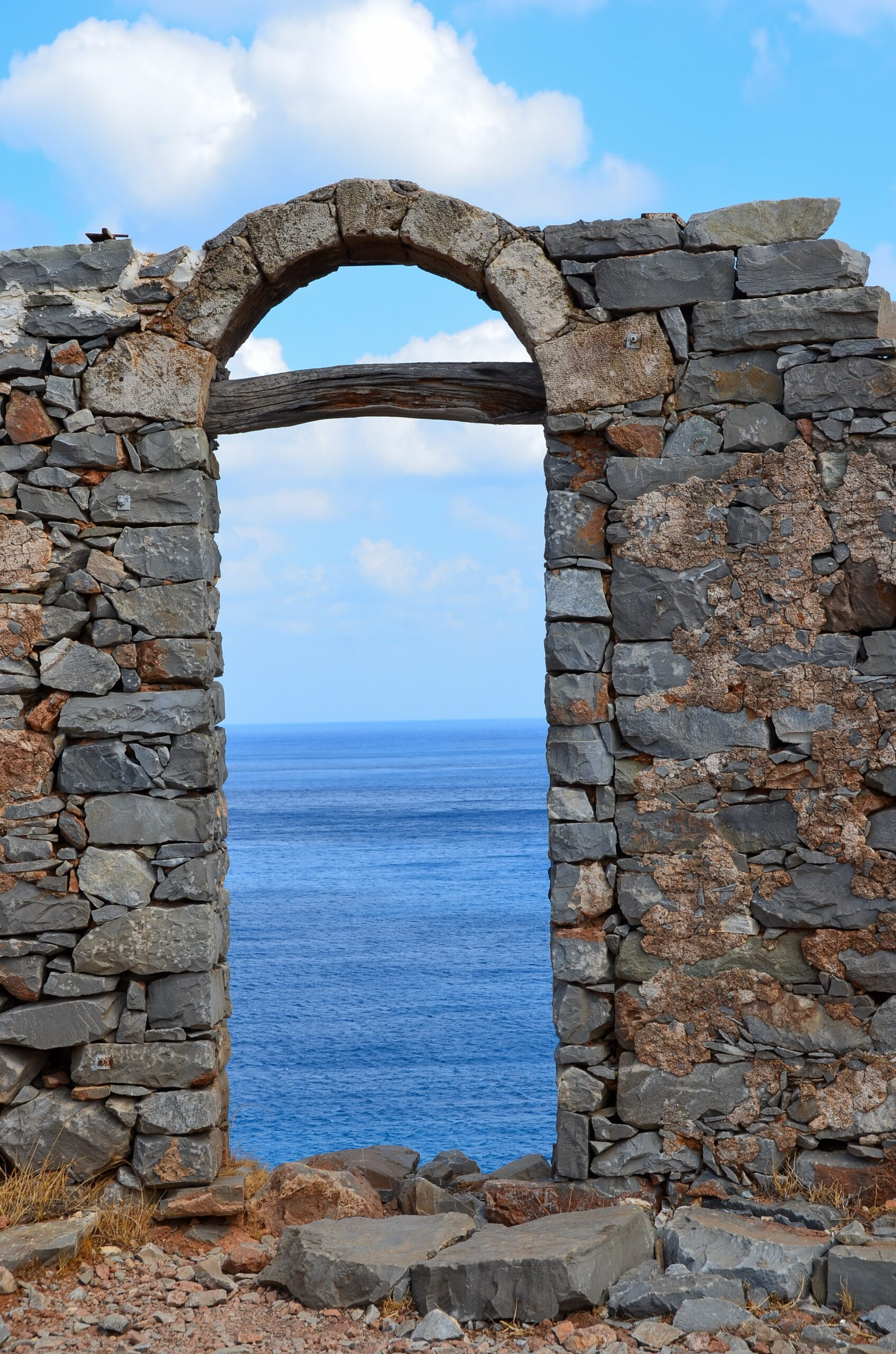 outside stone wall with entrance to the ocean