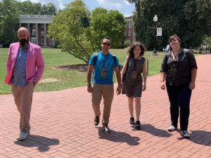 Robin DeRosa and three others walk on the Plymouth State University campus