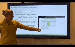 Person presents on the grade speculation calculator.
