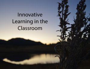 "The words ""Innovative learning in the classroom,"" against a dusk sky."