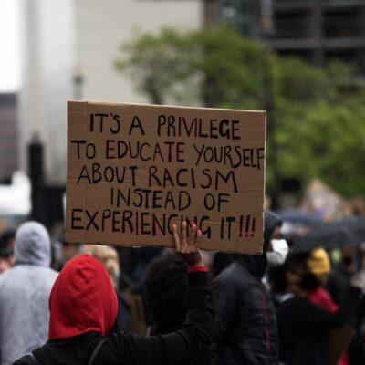 protest sign it is a privilege to educate yourself about racism instead of experiencing it