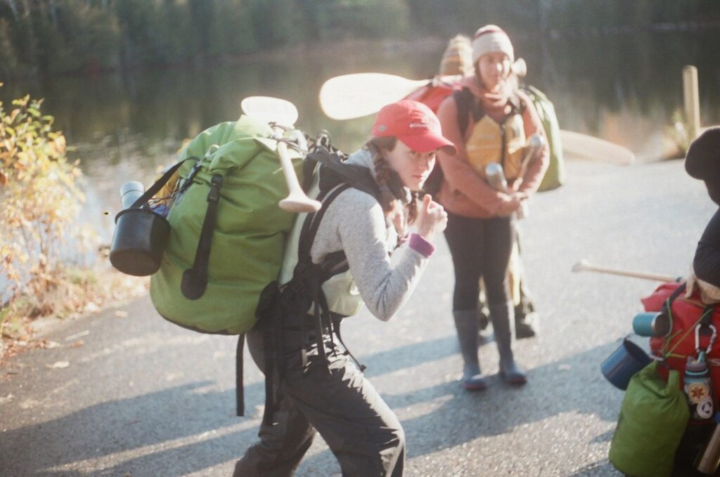 smiling woman with a thumbs up and a big hiking backpack