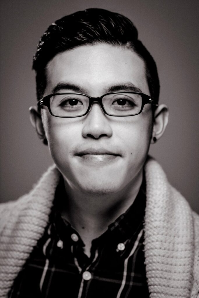 black and white photo of Travis Chi Wing Lao