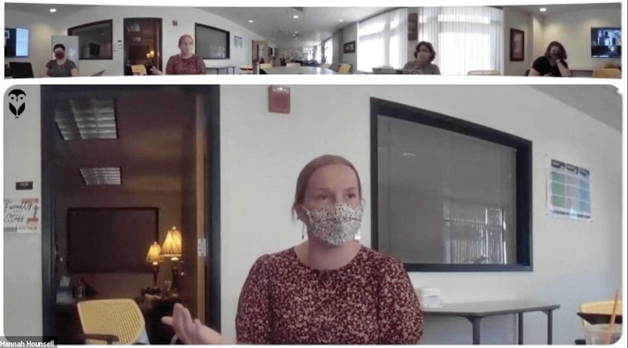 Blond woman in mask talking